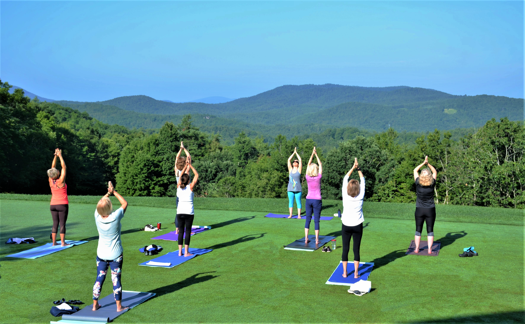 Fitness classes on the event lawn at Champion Hills